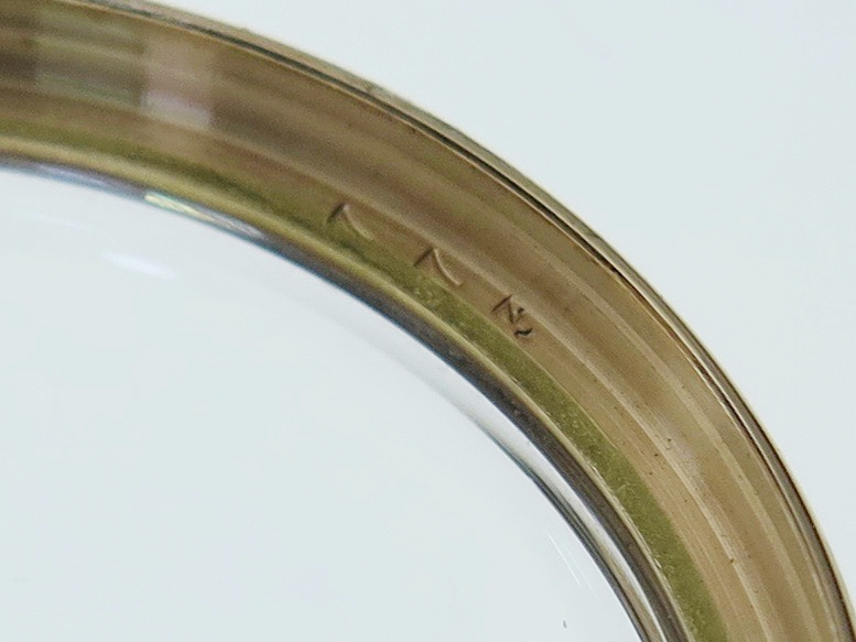 Case reference stamped into the inside of the bezel