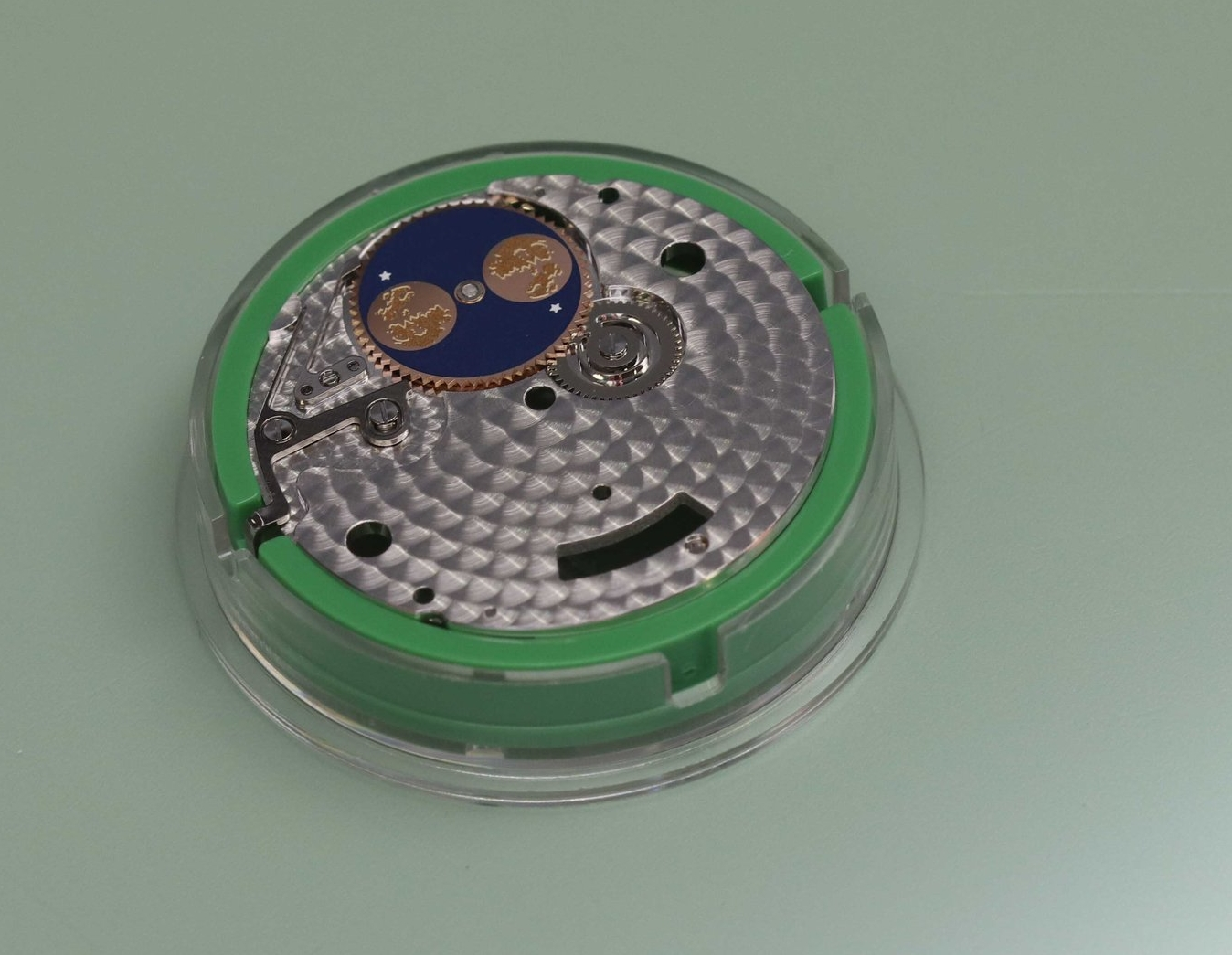 A module about to be placed on the movement.