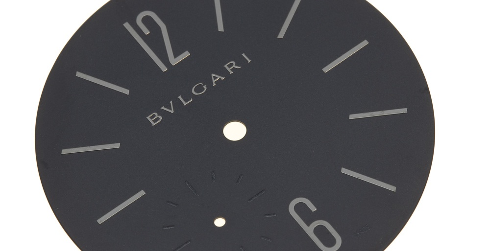 The indexes and name on the dial are chrome, injected onto the matt black surface.