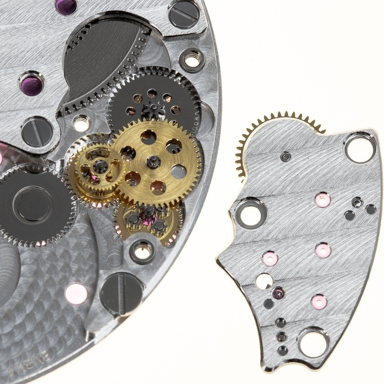 The reverser assemblies allow the rotor to wind the mainspring as it swings in both directions.