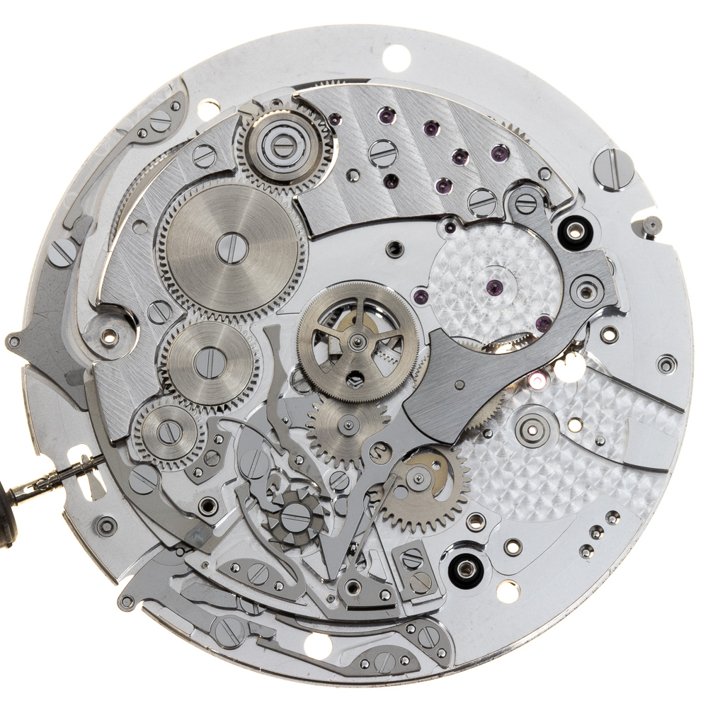 The largest lever in the chronograph construction is the coupling clutch which meshes with the upper third wheel and drives the chronograph.