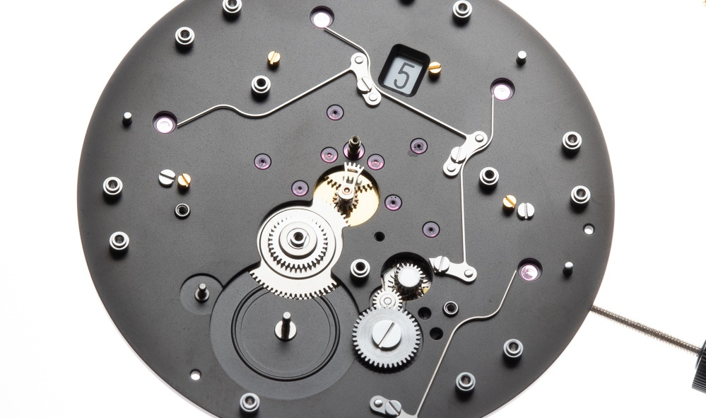 The long springs remaining in place are those that act on the seconds racks. The calendar mechanism is integrated into the base movement.