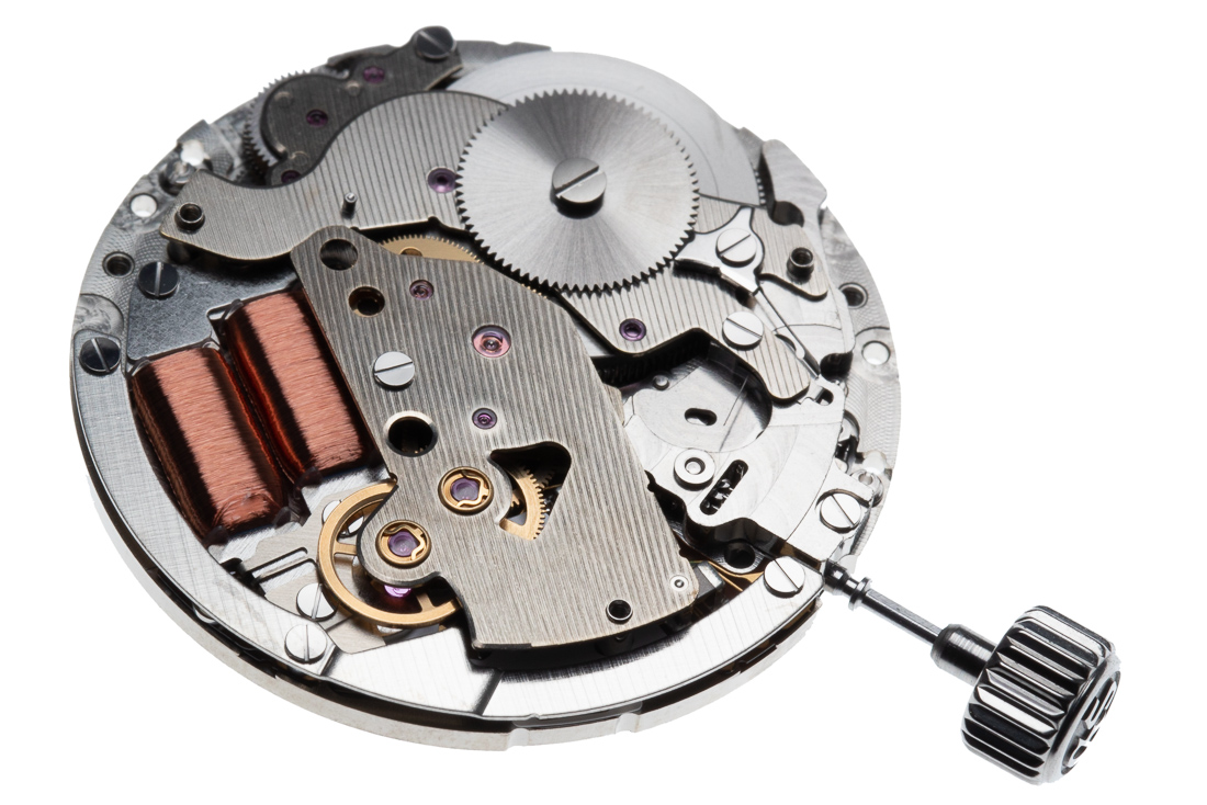 """The barrel at the rear of the movement drives the gear train leading to the spinning front wheel, whose speed is controlled by Spring Drive's unique tri-synchro regulator. The tri-synchro regulator applies electro magnetic braking to the glide wheel based on the accurate reference signal from the IC and quartz oscillator.  The """"tri"""" derives from three different sources of powers which it uses.  1. Mechanical energy, from the mainspring to drive the regulator.  2. Electrical energy, to create a reference signaling via an IC and quartz oscillator.  3. Electromagnetic energy, to apply a brake via a rotor/stator.  The Tri-synchro regulator controls the speed of the glide wheel and the hands with electromagnetic braking.."""