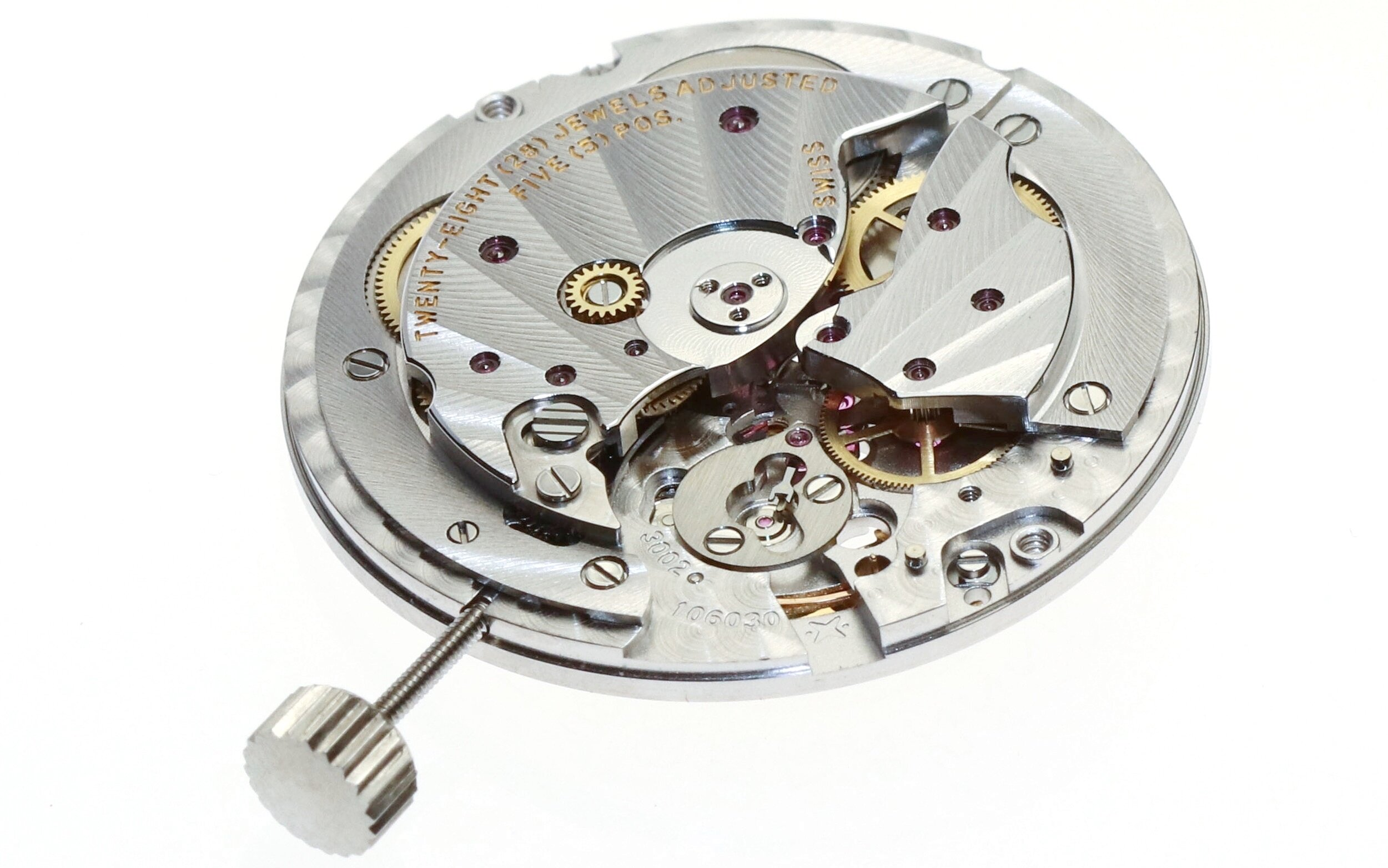 The movement with the rotor, balance cock and balance removed.
