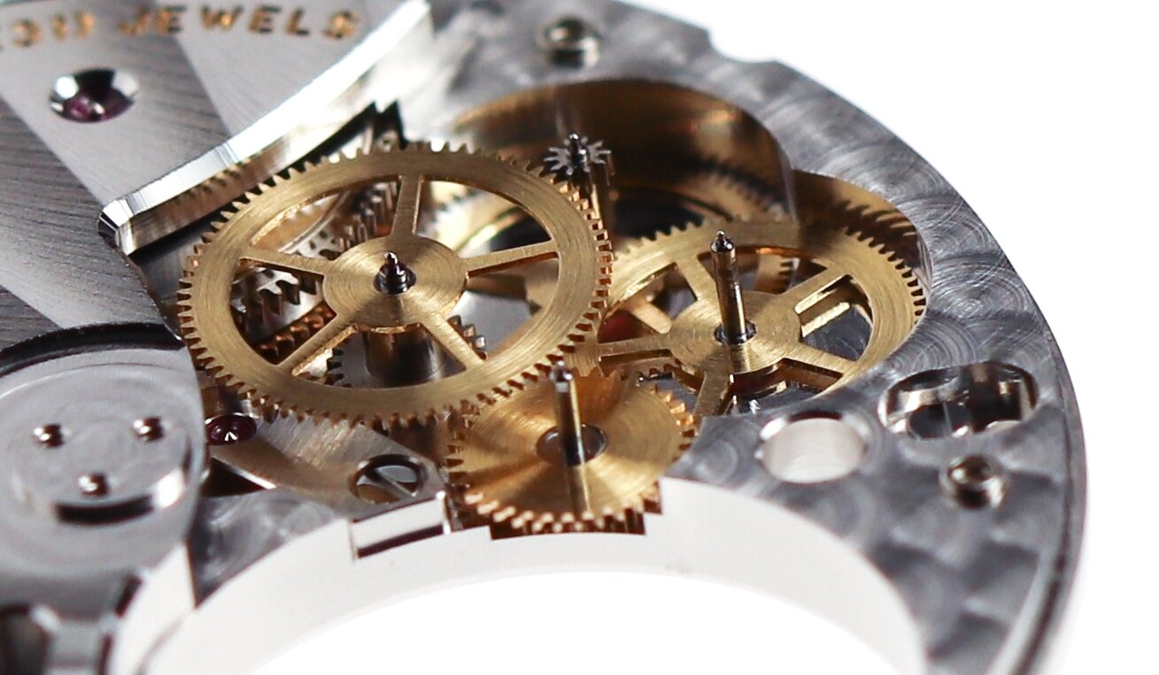 The tourbillon gear train, the small wheel at the centre of the image drives the cage.