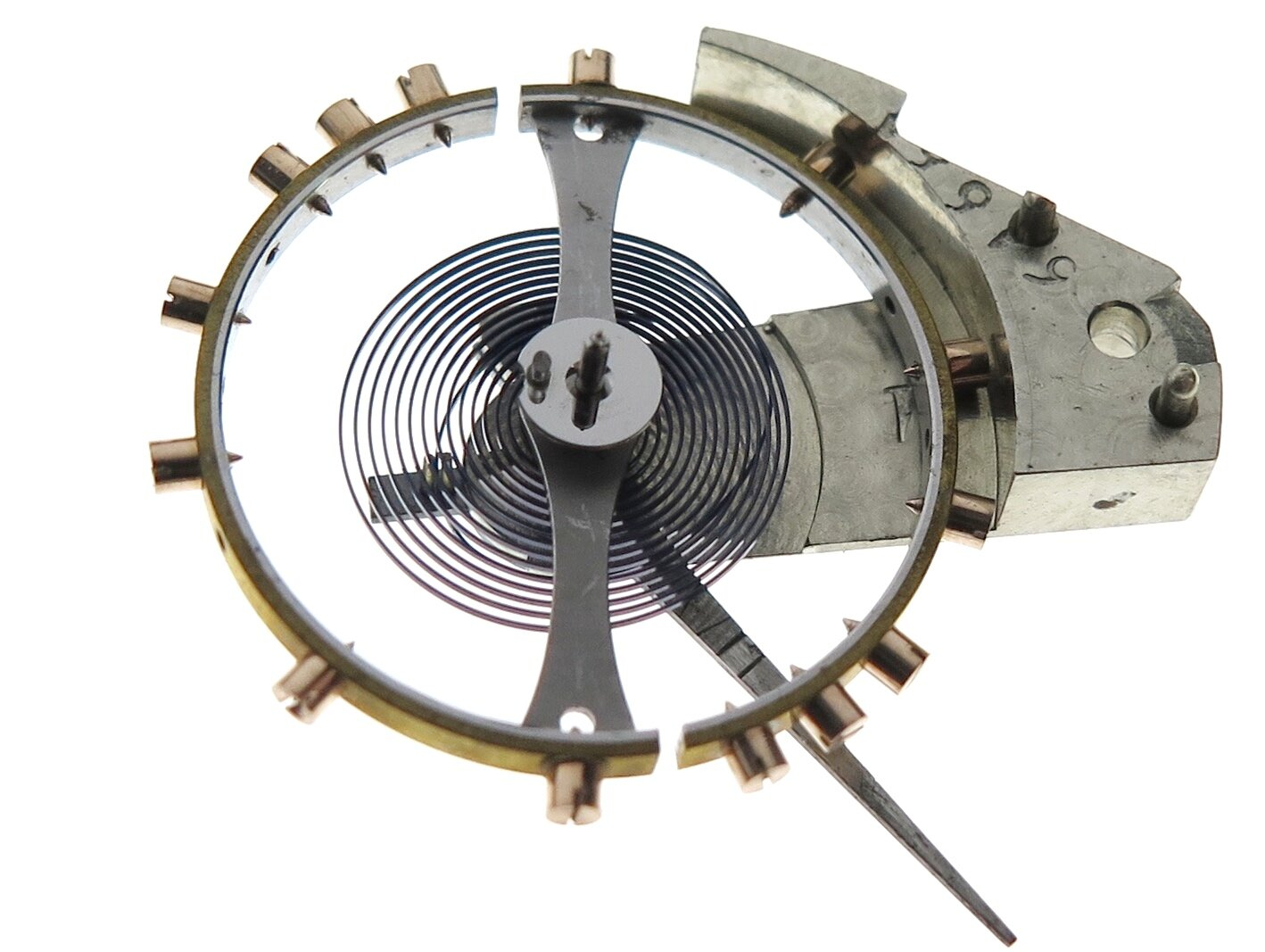 The small elliptical jewel in the centre of the image fixed to the polished steel circular plate is where the escapement lever (anchor) impulses the balance for it to oscillate.