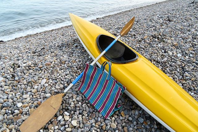 Picnic on the beach with our UPcycled kayak, oar and recycled shopping bag. We've got these on the website and in the shop! Can you believe the things people throw away?