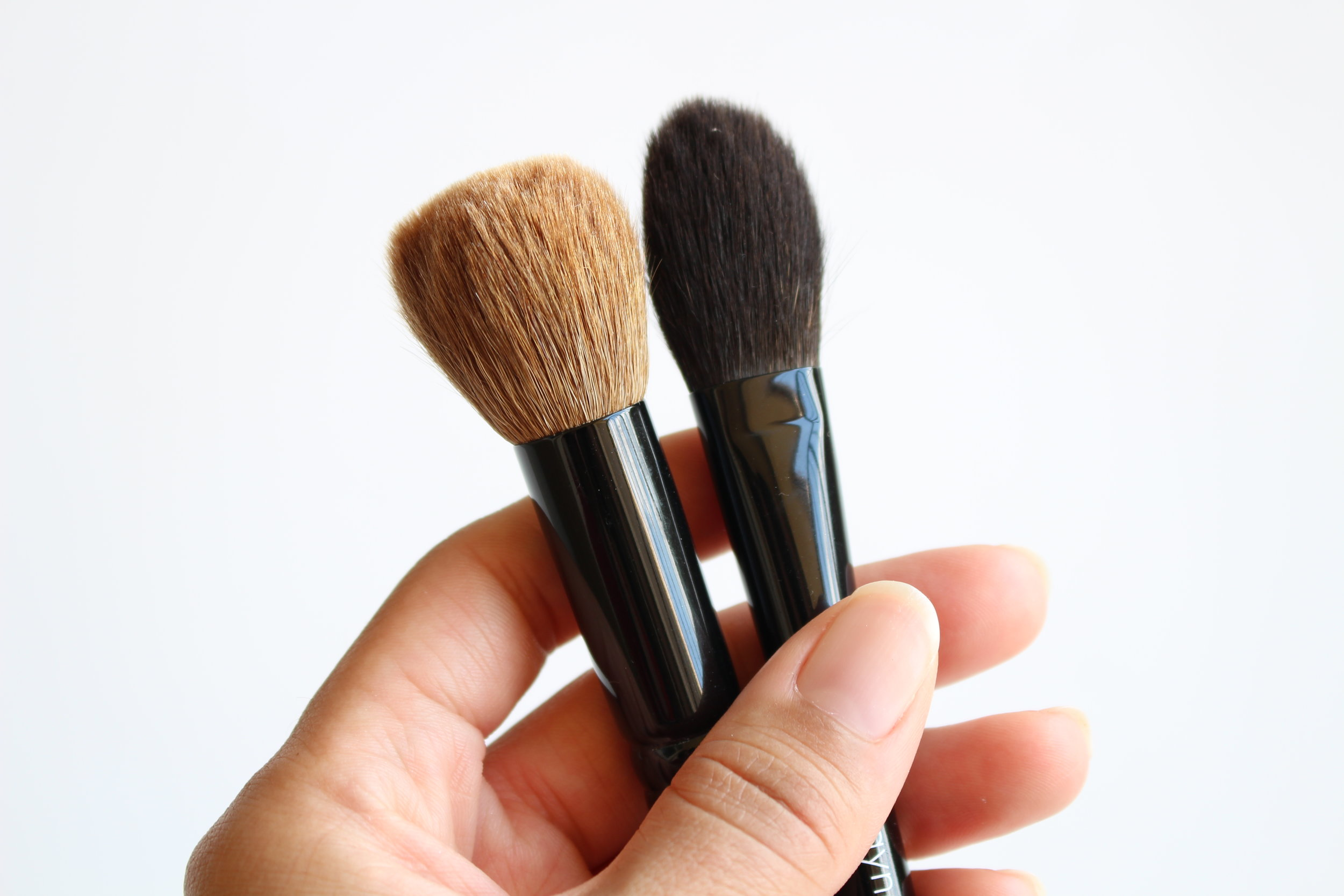 Two of my holy grail brushes: A Wayne Goss #13 and a Wayne Goss Air Brush