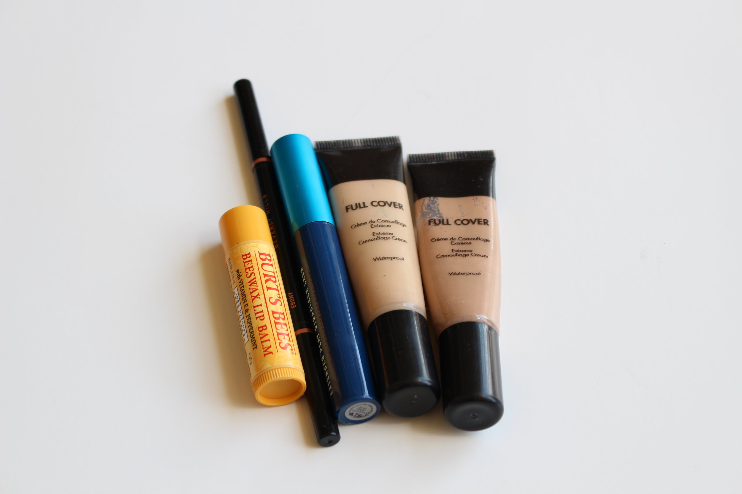 Well hello hello. Left to right: Burt's Bees Lip Balm, Anastasia Beverley Hills Brow Whiz, MAC Extended Play Mascara, Makeup Forever Full Cover Concealers