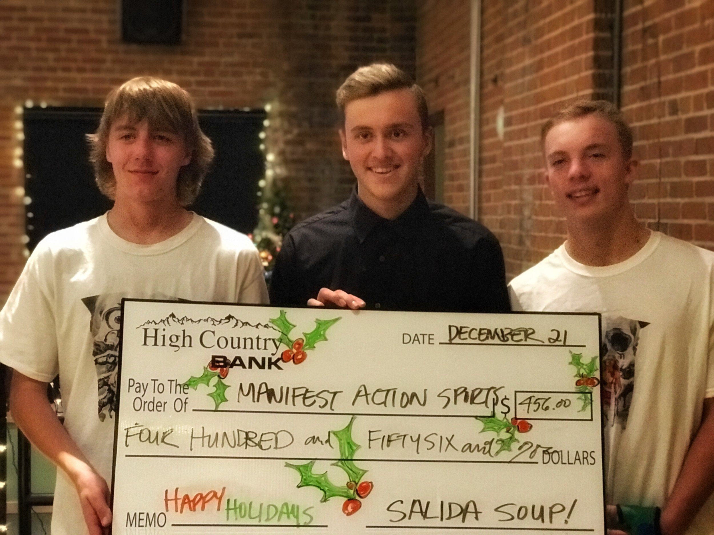 Slaid Waggoner (middle) and the Manifest Action Sports crew posed with the Big Soup Check as the winners of Salida Soup 31 on Thursday, December 21.