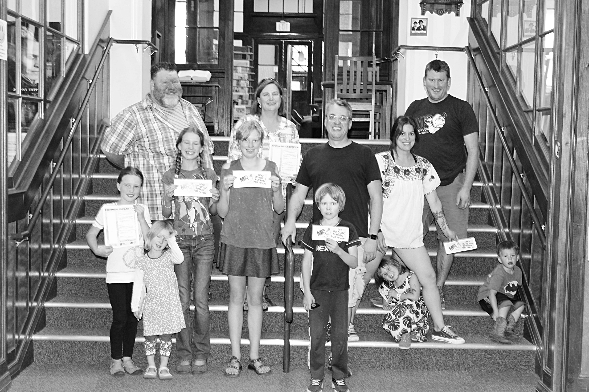 Participants and supporters gather at Salida Regional Library to kick off the PfCA Bookmarks for Burritos Program. From left front are Tatum Miller, Dinah Miller, Maya Miller, Harper Hartman, Jesse Hawley, Mabel Gartzman and Ozzie Gartzman. Back: Jimmy Sellars, Susan Matthews, Mark Monroe, Sarah Gartzman, and Rob Gartzman. Photo by Sam Klomhaus from  The Mountain Mail .