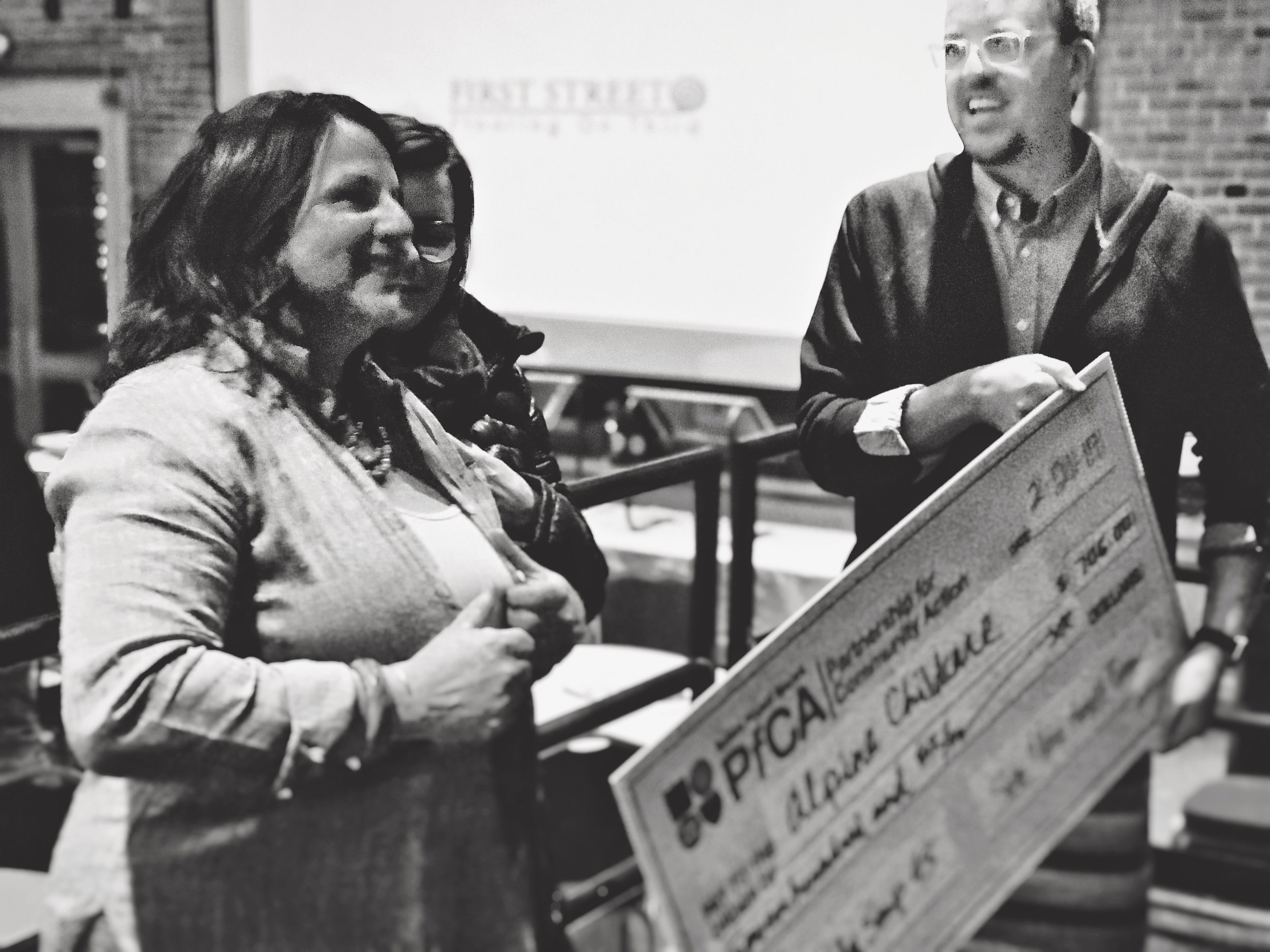 Kate McClelland, representing the group supporting the new center, with the Big Check after their win at Salida Soup 45 on February 21st.