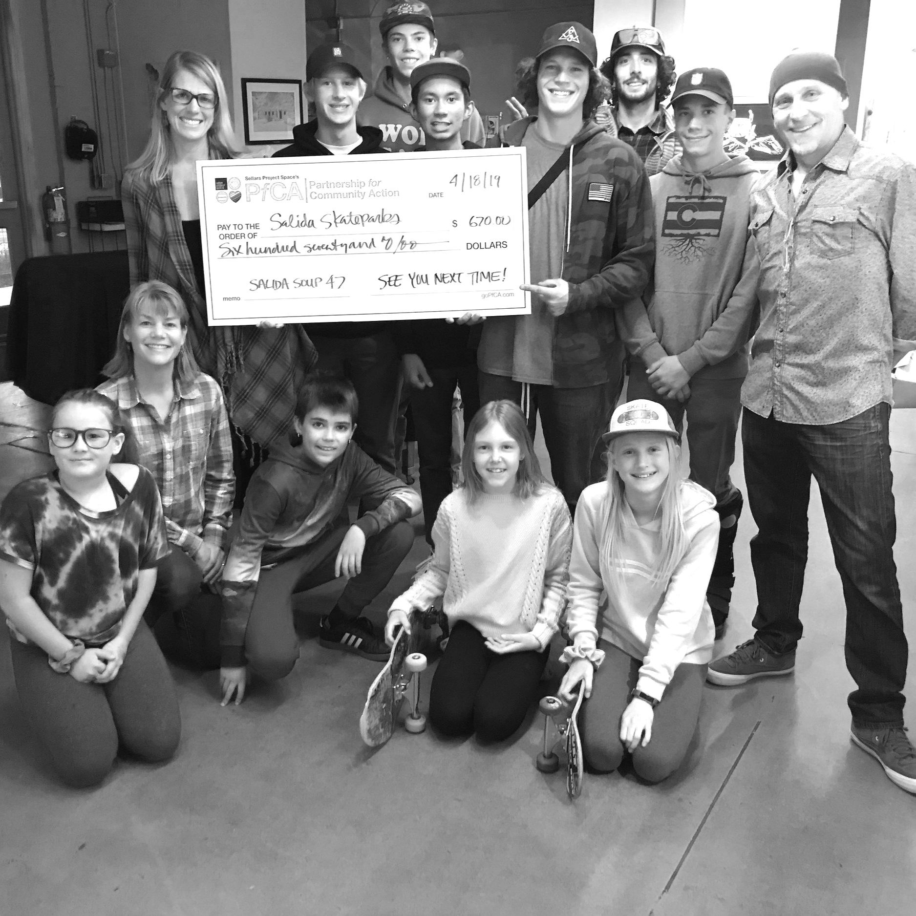 The Friends of Salida Skateparks crew poses with the Big Check after their Salida Soup 47 win.