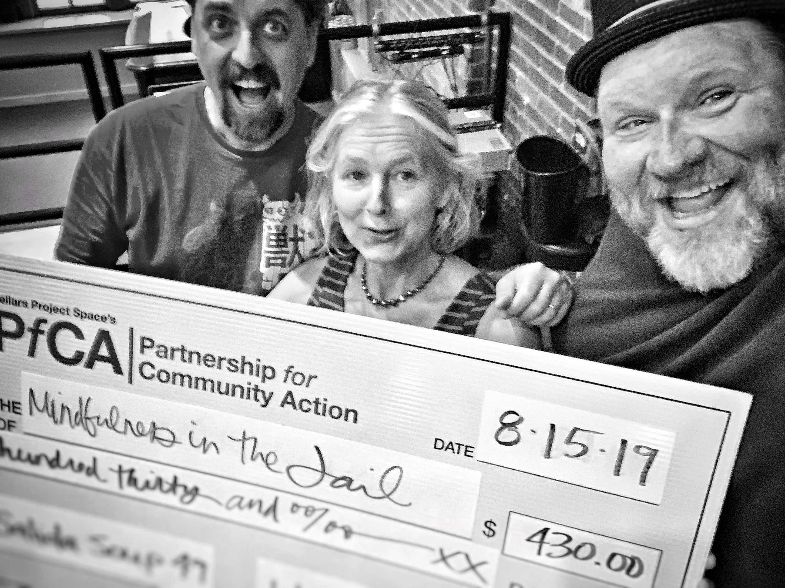 Mark and Jimmy of the PfCA pose with Denise Ackert, whose Mindfulness in the Jail program won the Big Check of $430 at Salida Soup 49 on August 15th.