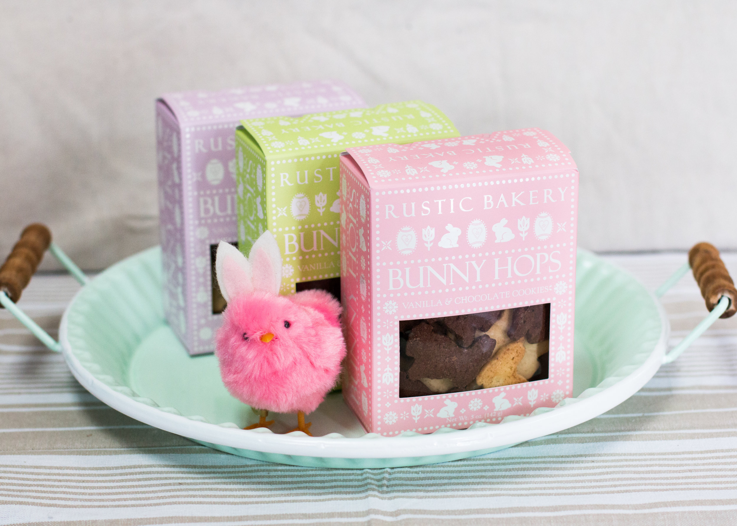 Bring along a pastel-hued box of adorable bunny cookies to serve up with coffee after the easter feast.