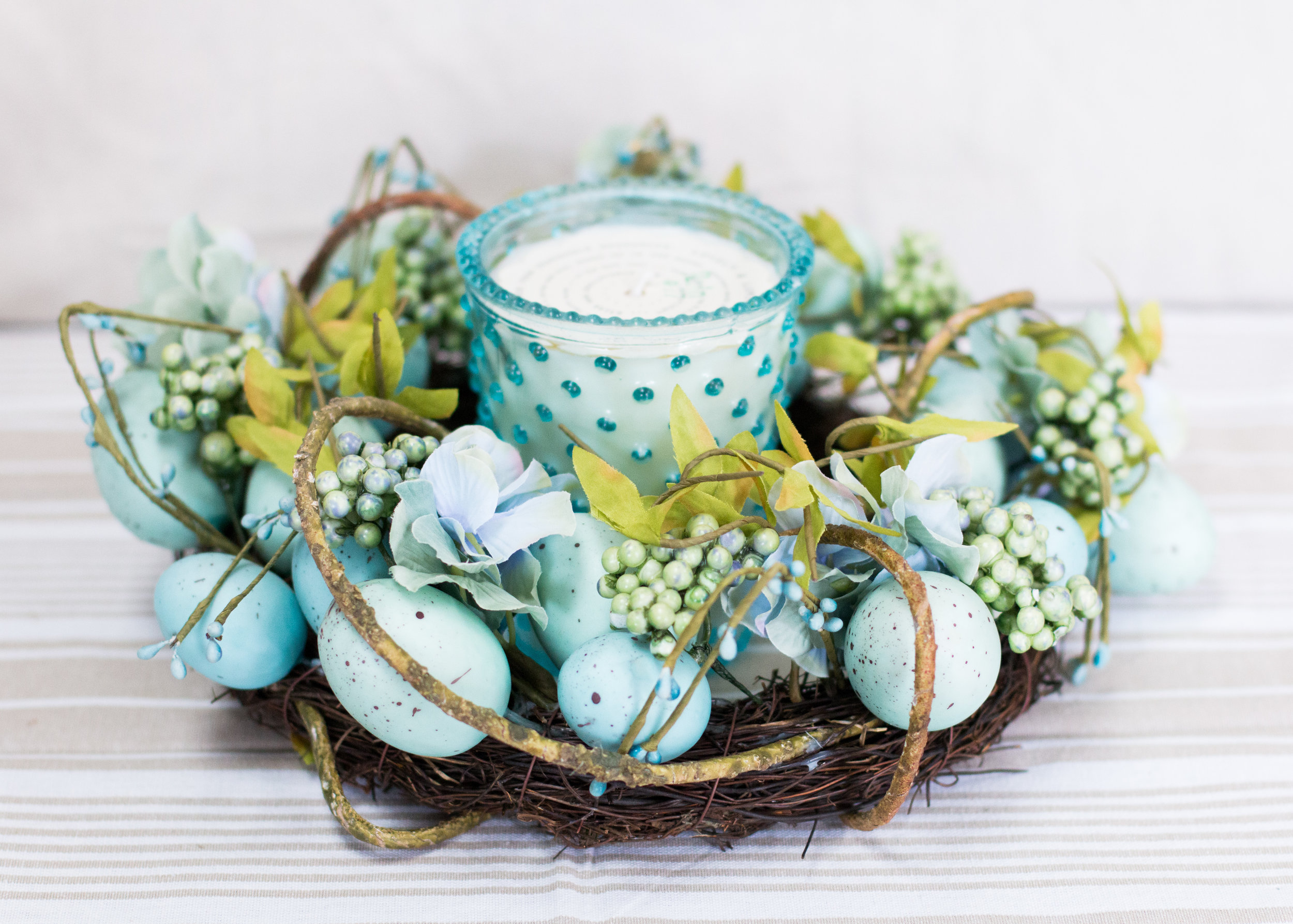 Our blue egg wreaths are the perfect spring decor accent - try it on a table top insead of hung on the wall! A sweet accompaniment to our hobnail glass candles.