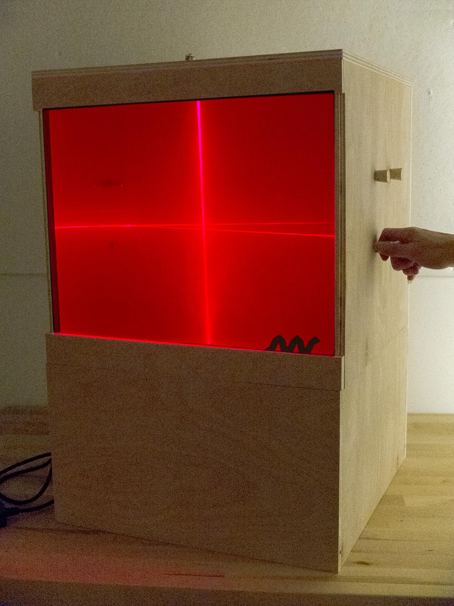 LaserBoxInProgressWithHand.jpg