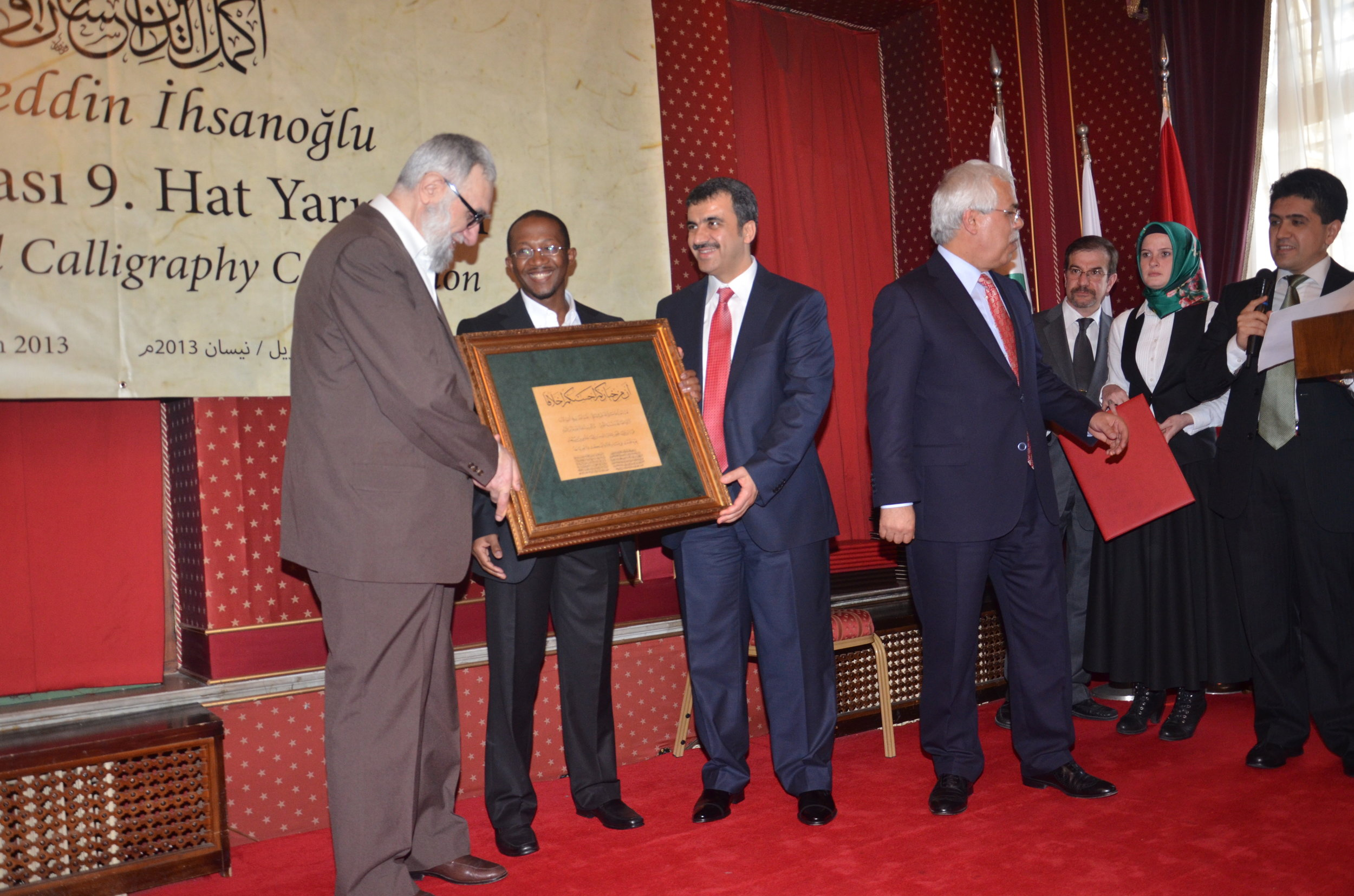 Muhammed Hobe receiving his ijaza (license) from grand master Hasan Celebi and event organisers.