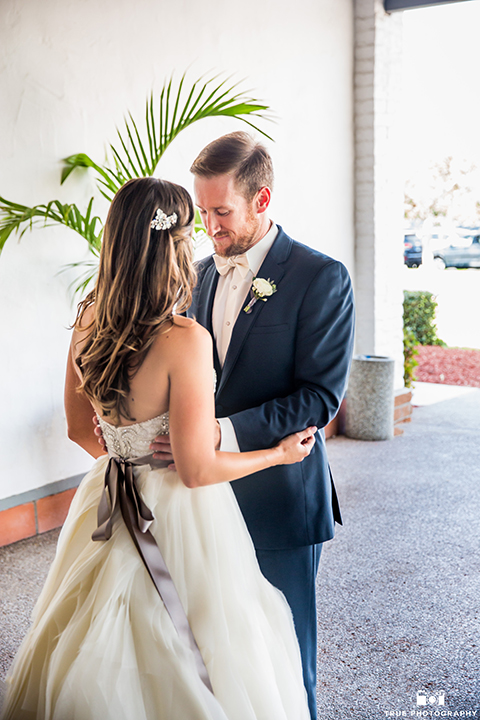 San-Diego-wedding-at-lomas-santa-fe-country-club-groom-and-bride-first-look.jpg