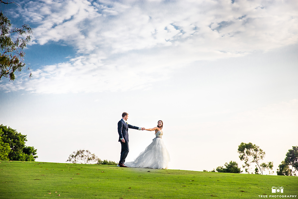 San-Diego-wedding-at-lomas-santa-fe-country-club-bride-and-groom-walking-and-holding-hands.jpg