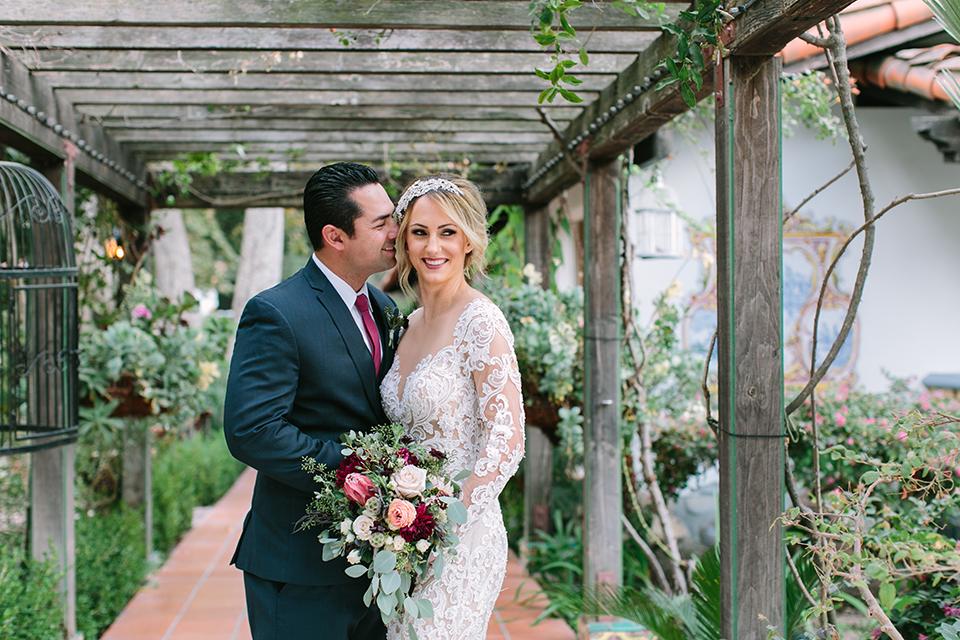 Orange-county-wedding-shoot-at-rancho-las-lomas-bride-and-groom-hugging-and-smiling.jpg