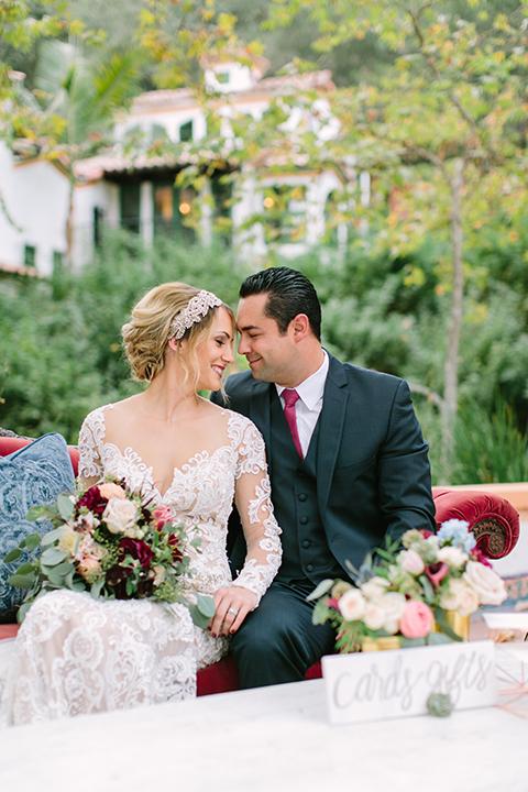 Orange-county-wedding-shoot-at-rancho-las-lomas-bride-and-groom-sitting-at-table-close-up.jpg