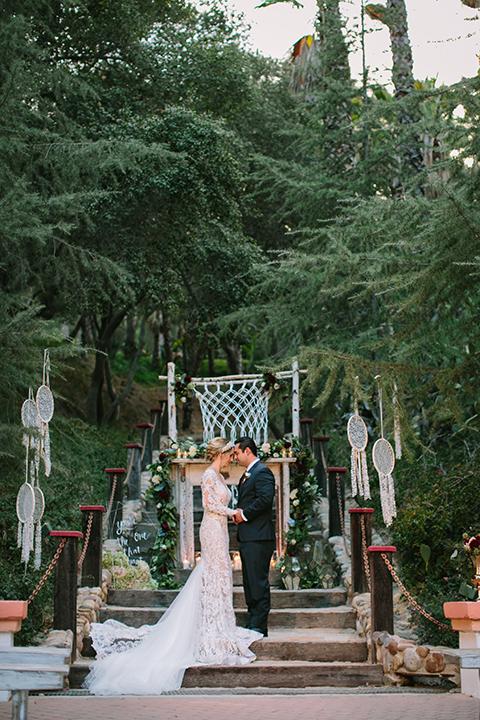 Orange-county-wedding-shoot-at-rancho-las-lomas-ceremony-bride-and-groom-holding-hands.jpg