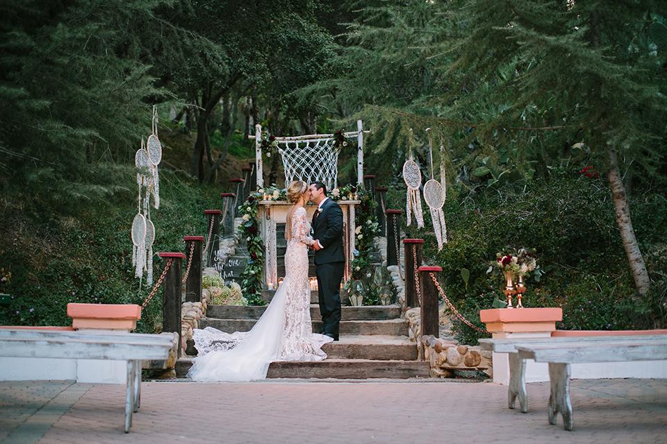 Orange-county-wedding-shoot-at-rancho-las-lomas-ceremony-bride-and-groom-kissing.jpg