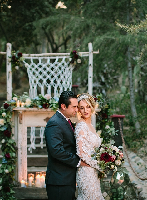 Orange-county-wedding-shoot-at-rancho-las-lomas-ceremony-bride-and-groom-hugging-close-up.jpg