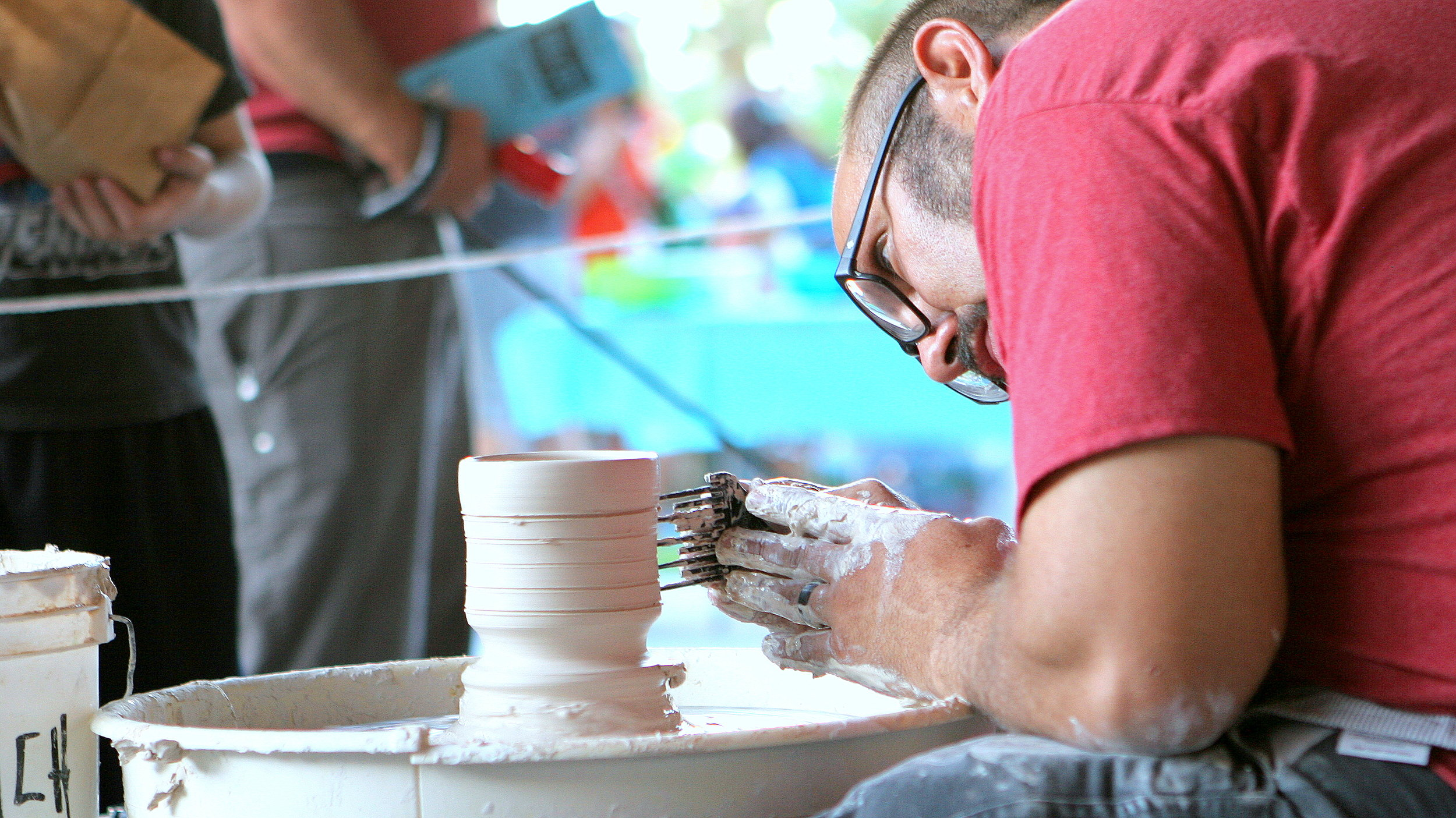 Ryan Reich works his potters wheel at Brea Fest.
