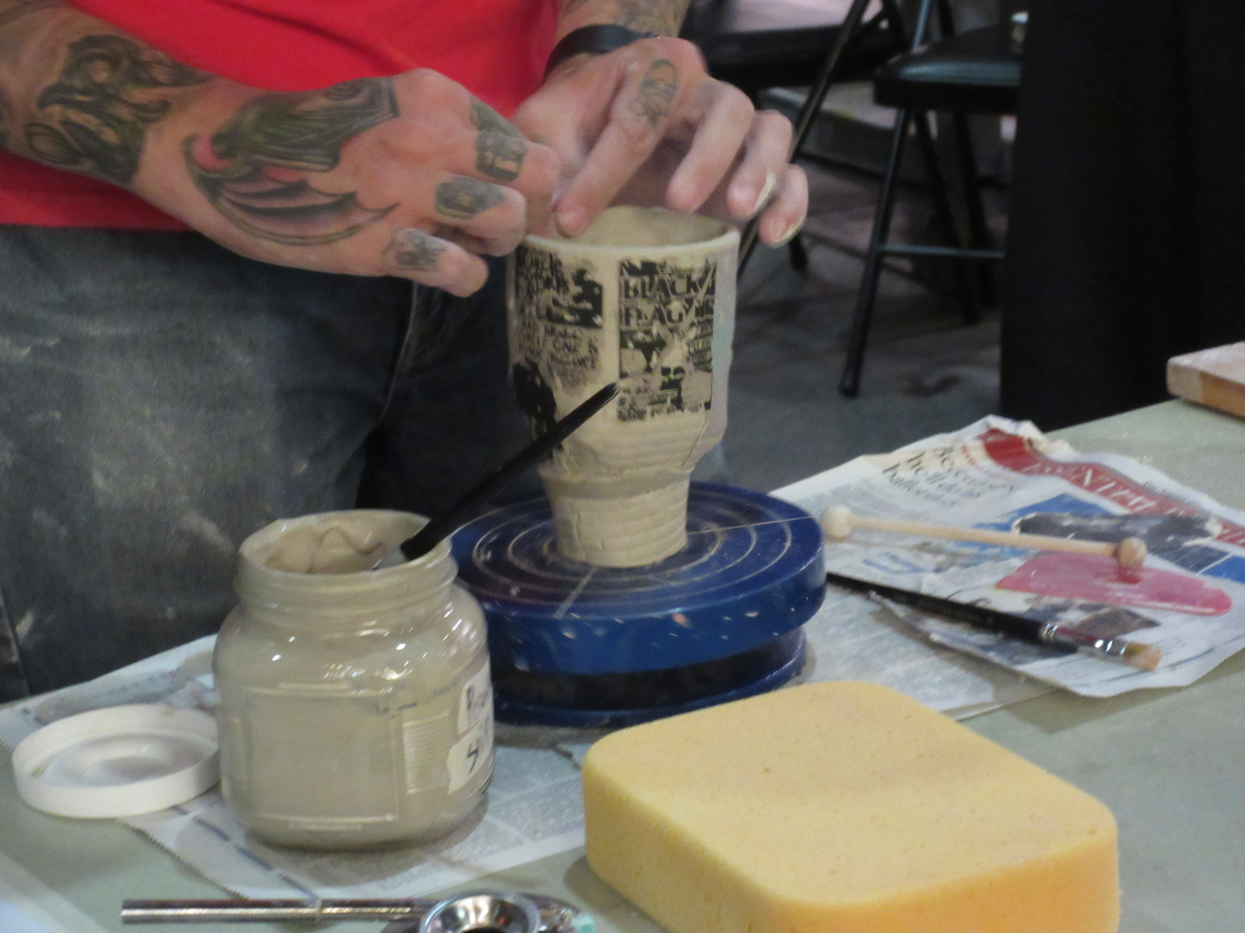 Michael Nightmare works on a new cup at Brea Fest perfecting the lip just right!