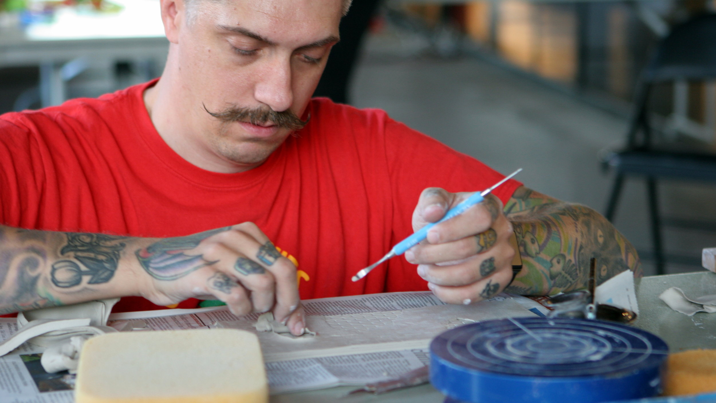 Michael working by hand on some small details.