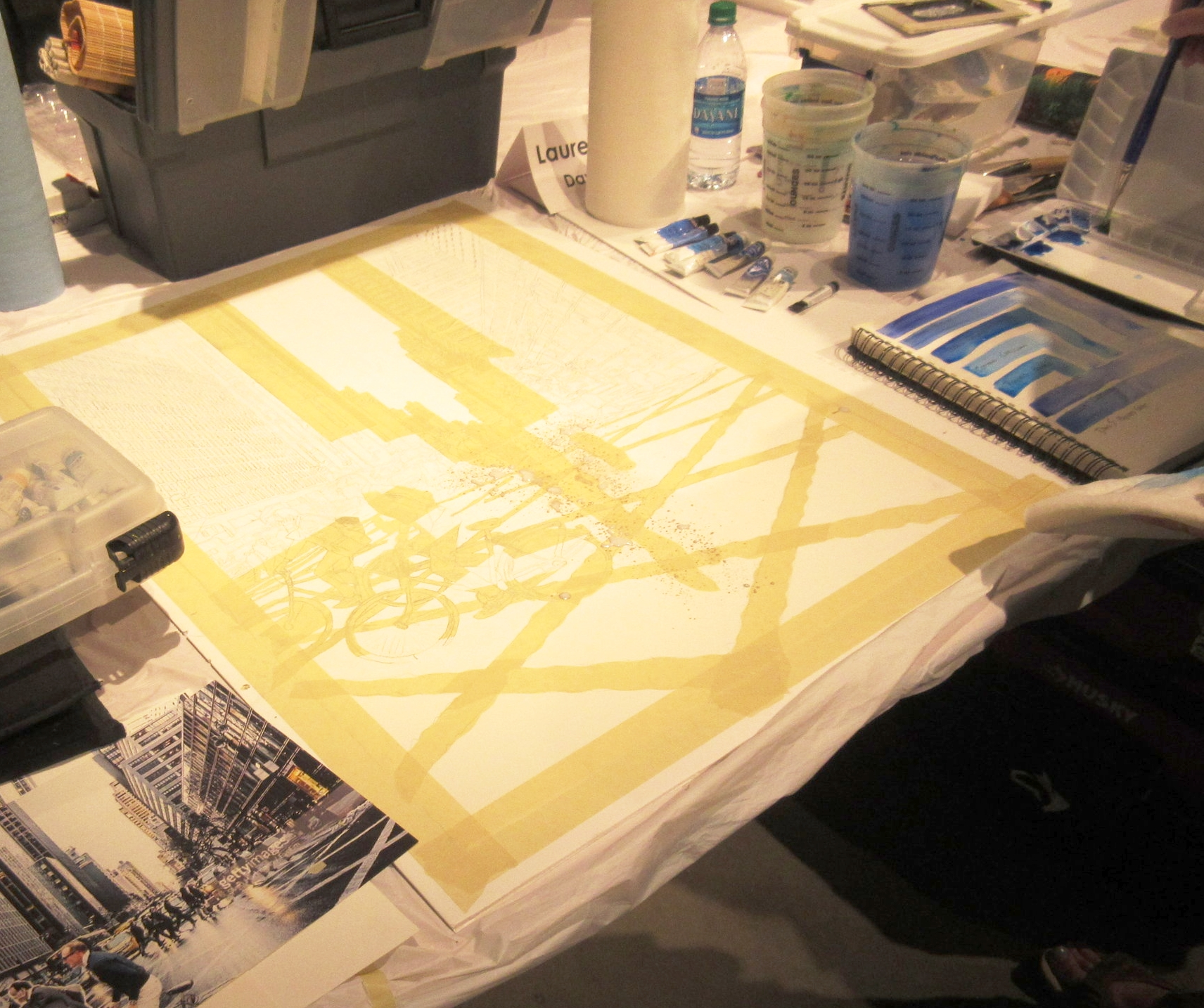 Before paint is applied to the paper, masking tape blocks out the spaces the artist doesn't want color.
