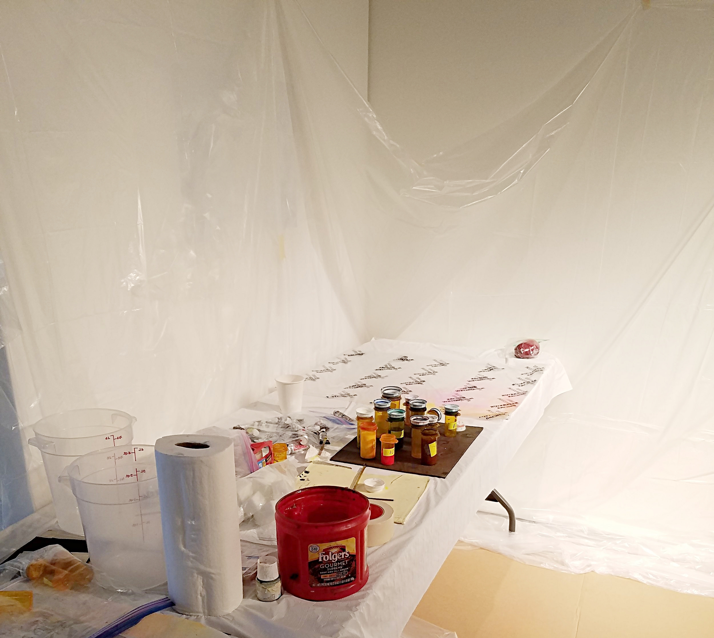 """An """"atomizing station"""" allows for students to get messy when experimenting with spraying color on their paintings."""
