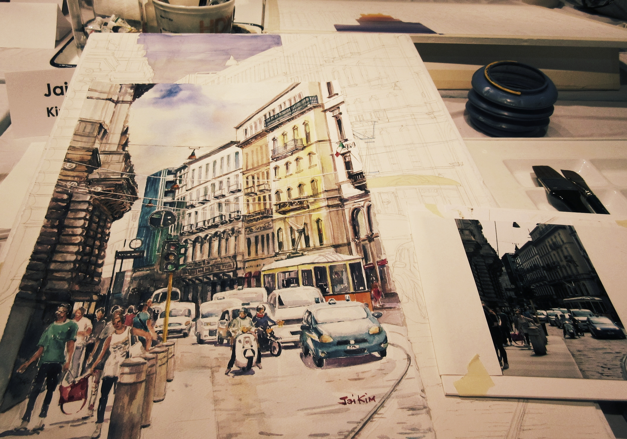 A student in John Salminen's Urban Realism class works from a photo.