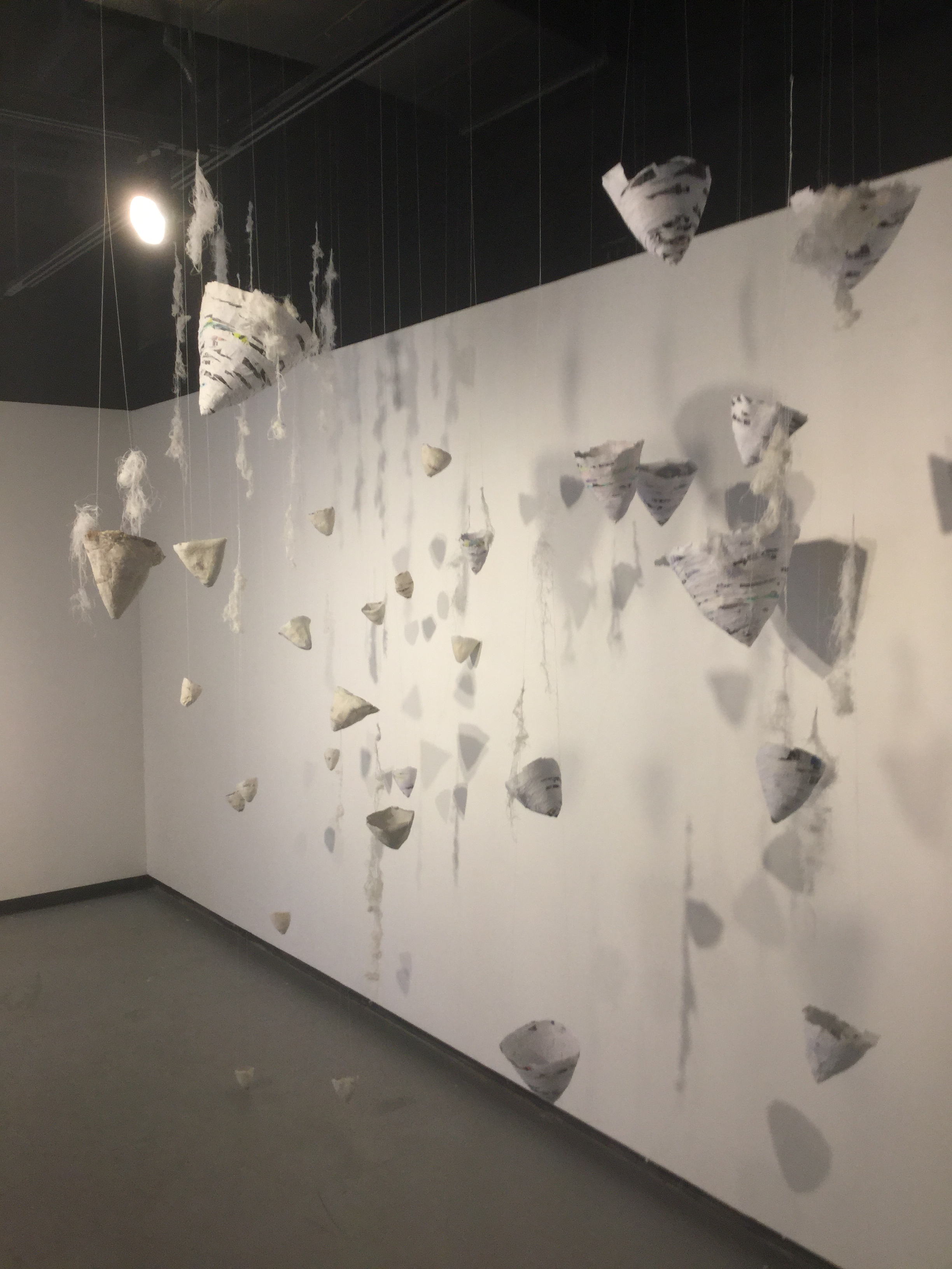 Untitled Installation    Amy Williams  Collected Paper, Porcelain Slip, Thread, Wire, 2017  12'x6'x4'  $800.00