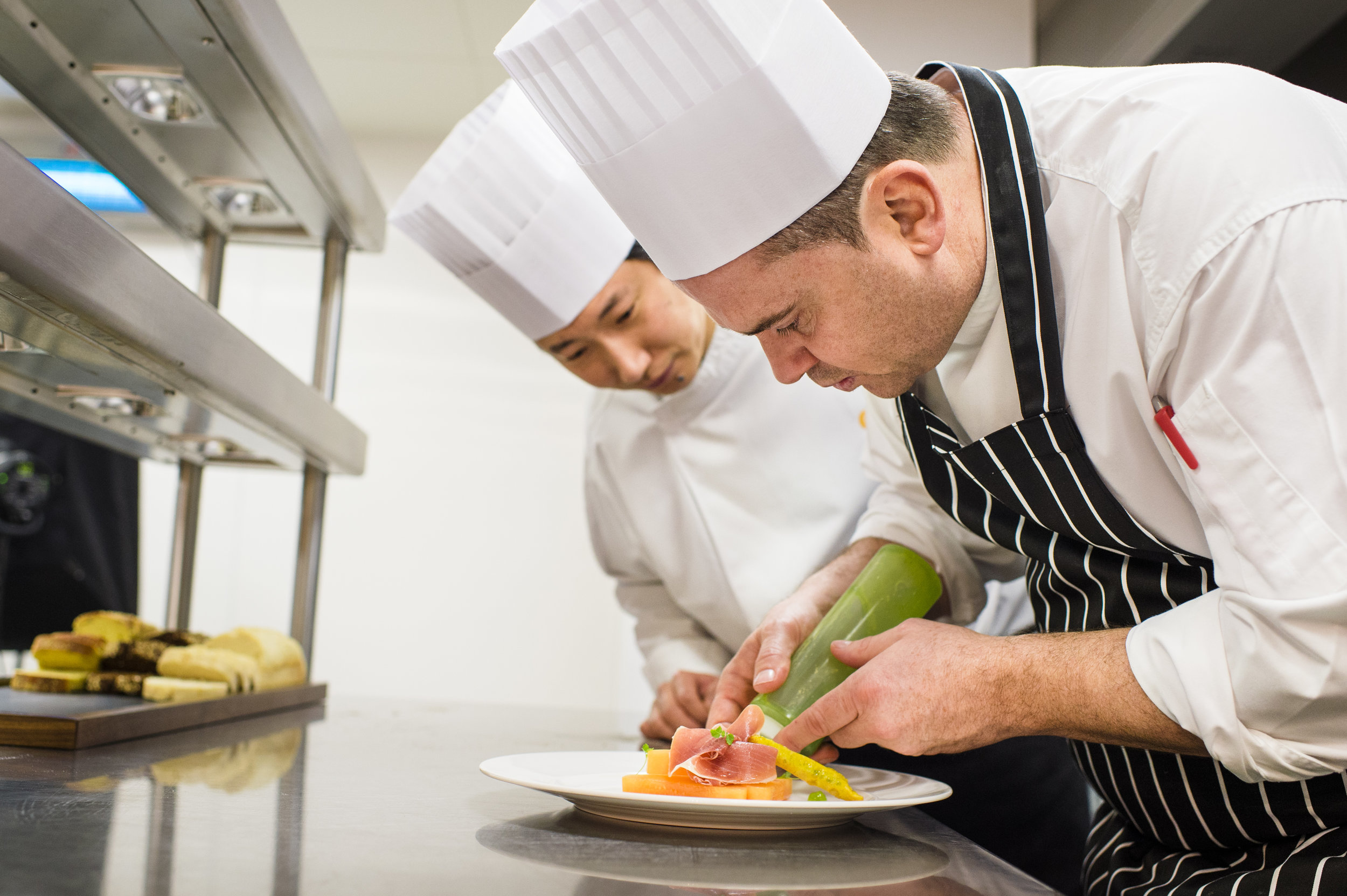Fitzers Catering chef putting finishing touches on a main.jpg