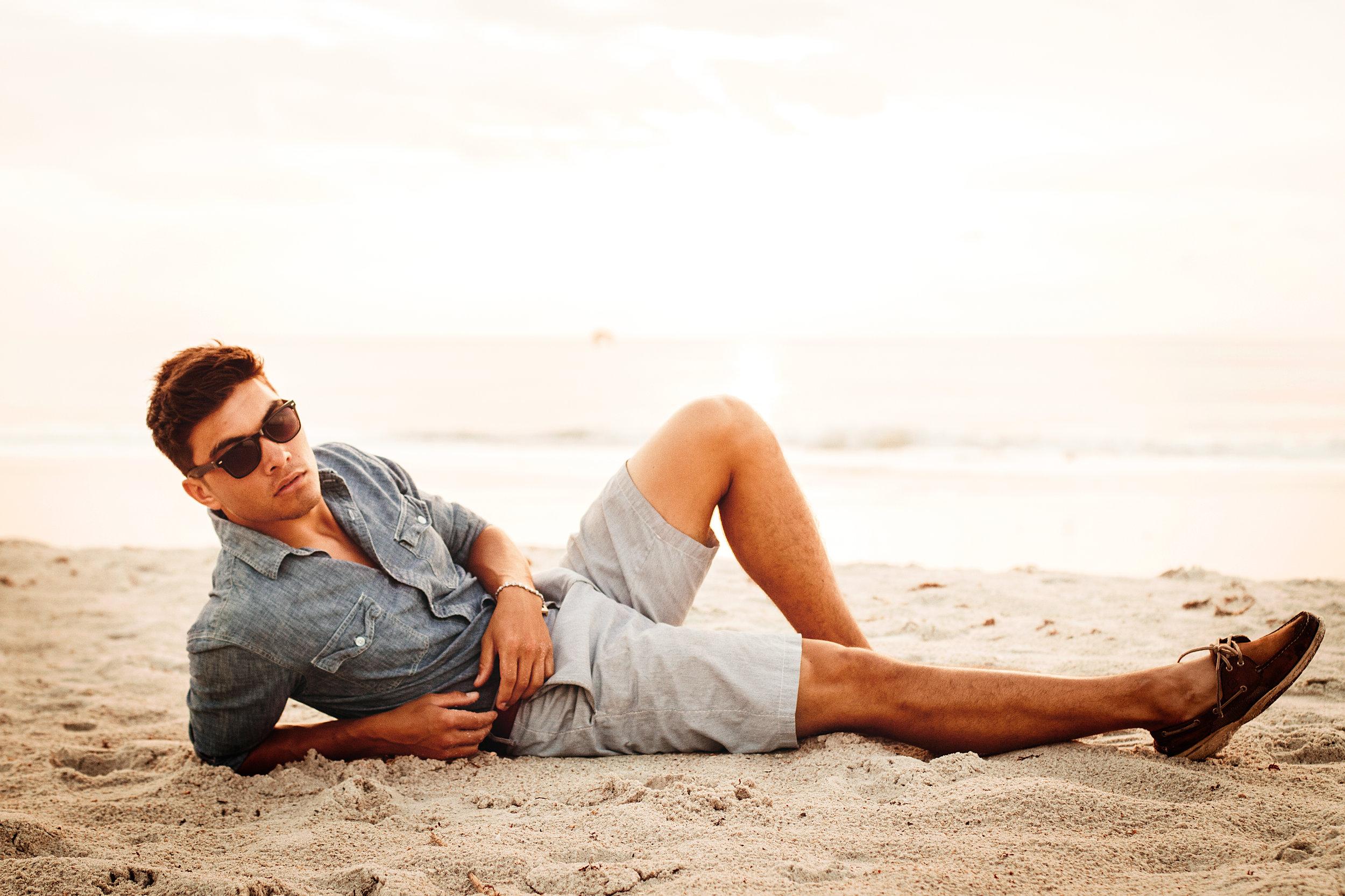 Roman Fashion Shoot Beach Jacksonville Laying In Sand.jpg