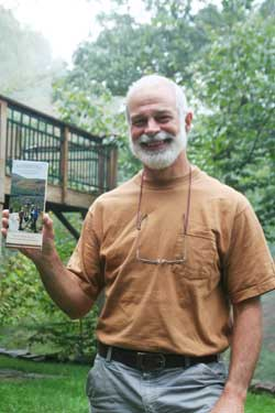 "Burt Kornegay, author of ""A Guide's Guide to Panthertown"", shows off a copy of his essential map & guide for exploring Panthertown Valley."