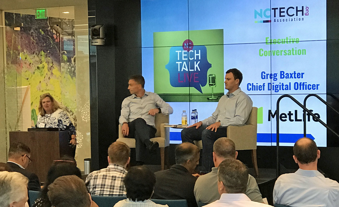Greg Baxter, chief digital officer at MetLife, and Neal Davis, chief executive officer at Dais X, discuss the future of insurance at the MetLife Global Technology & Operations campus in Cary, NC.