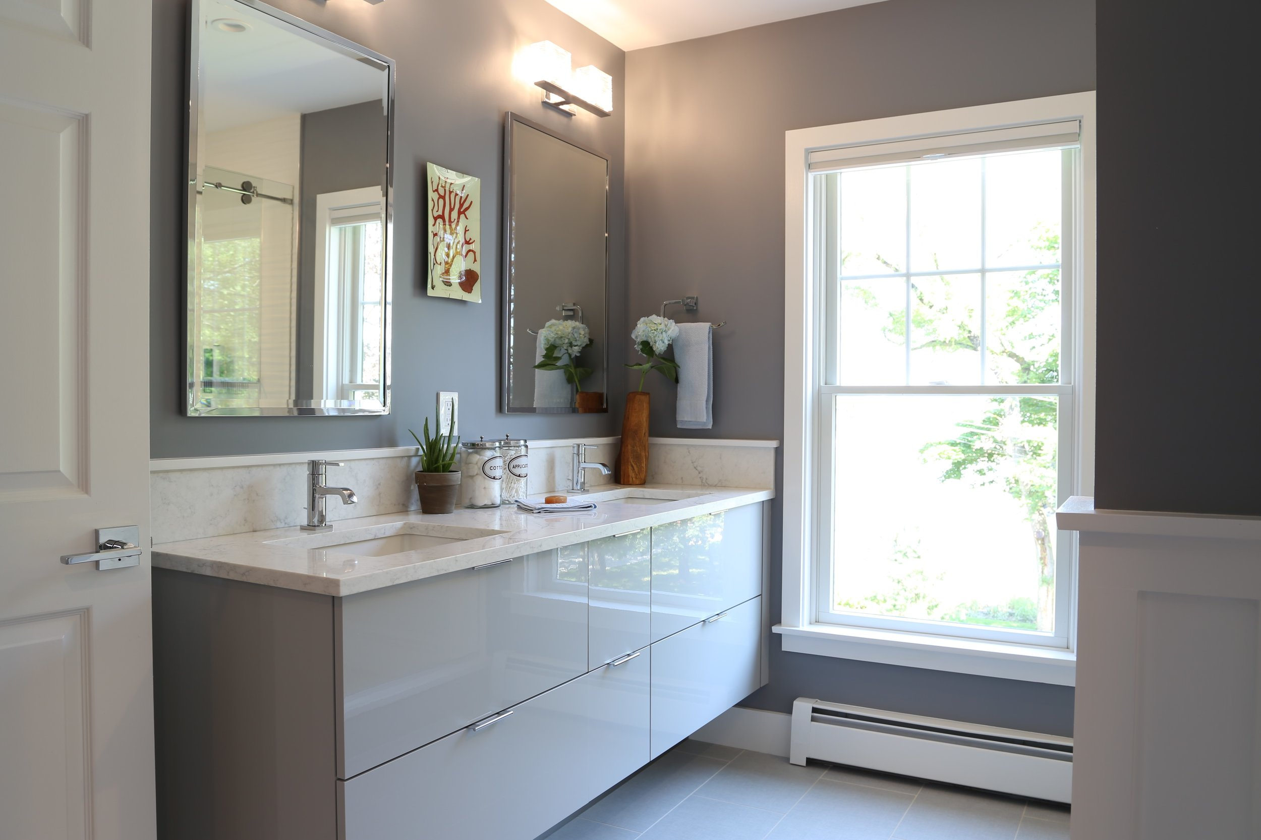 Floating Vanity - A modern floating vanity with clean simple line provides ample storage and easy to clean floor beneath.