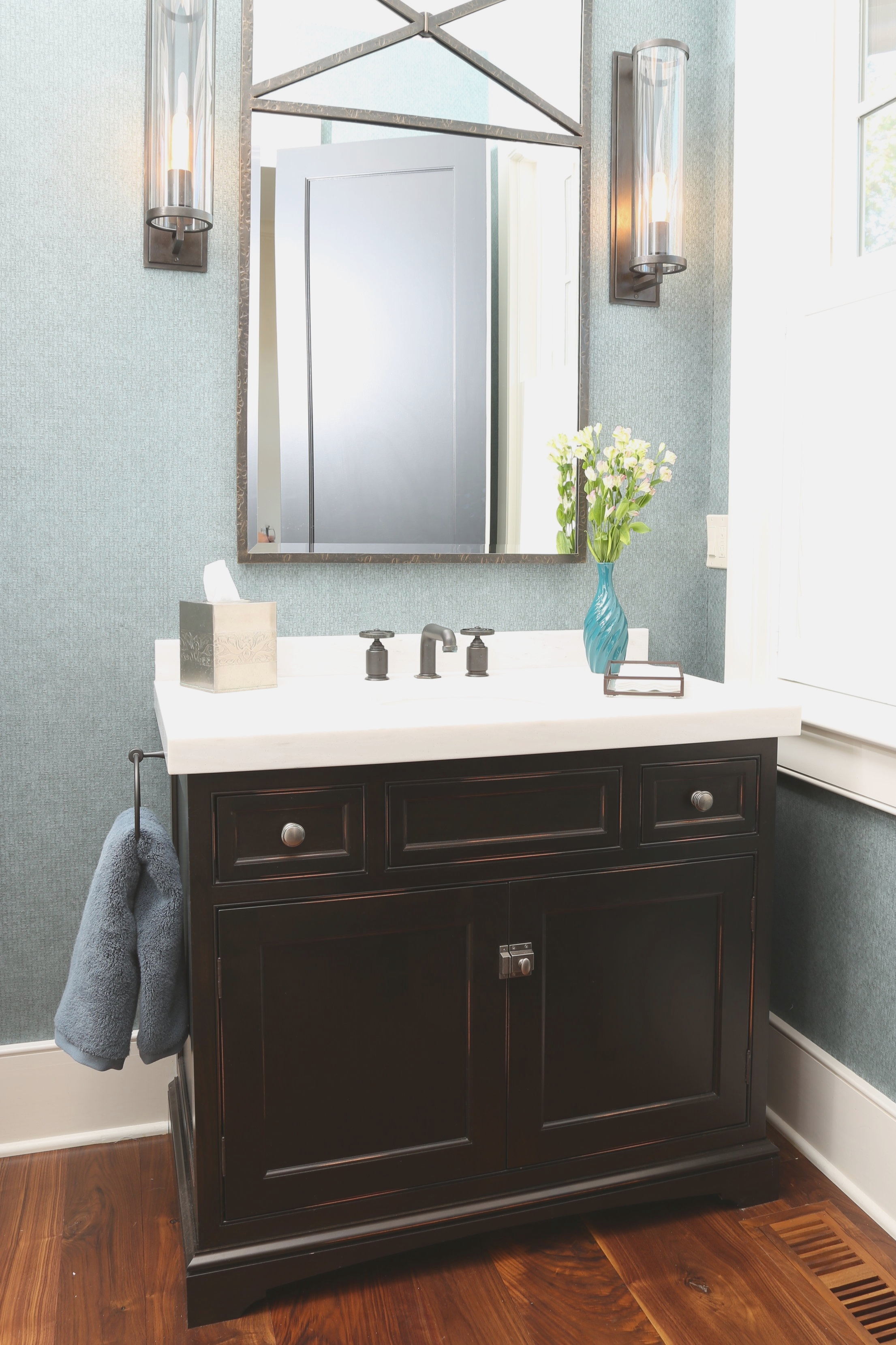 Powder Room - A custom vanity can serve a power room with style, efficiency, and storage despite the small footprint of room.