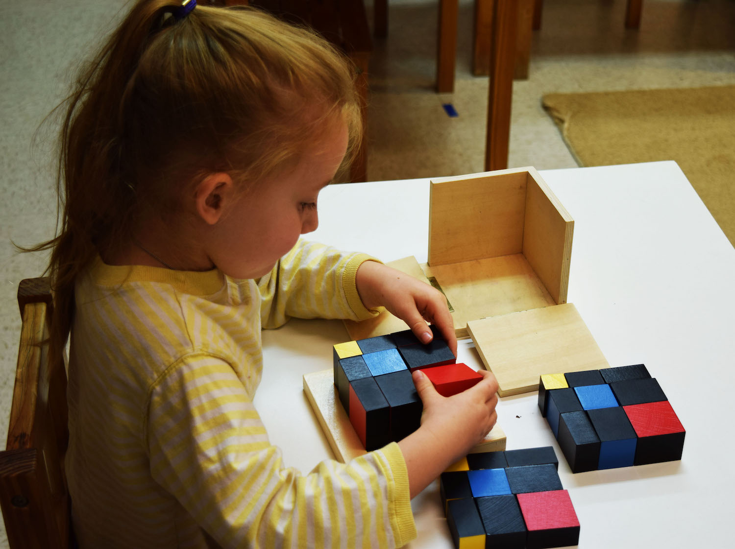 Child Performing Montessori Work.JPG