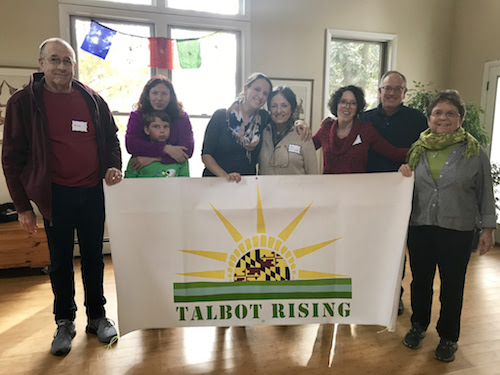 Emily Phelps, in the center with her mom, Holly Wright, works with Indivisible in Washington, D.C., and visited the Talbot Rising general meeting on Nov. 18 to give an update on progress around the country.