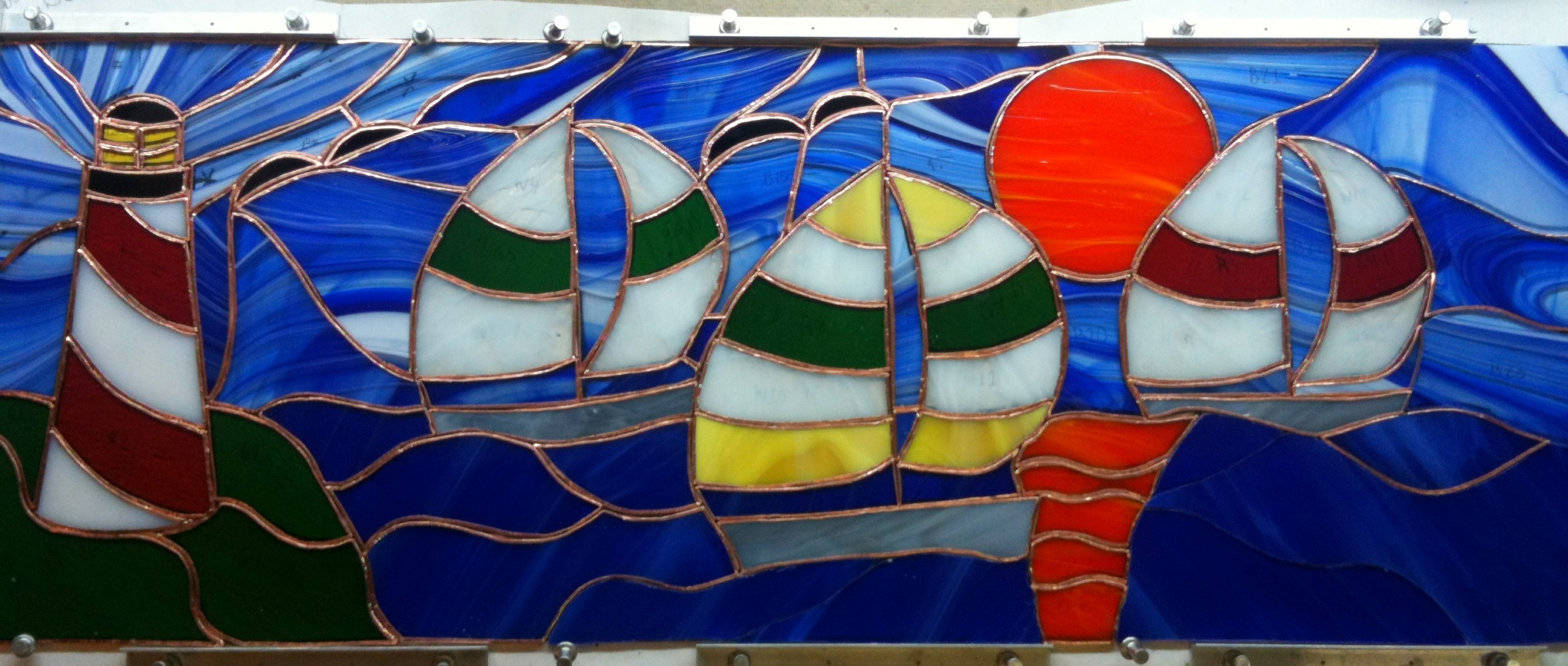stained_glass_sailboat_lighthouse.JPG