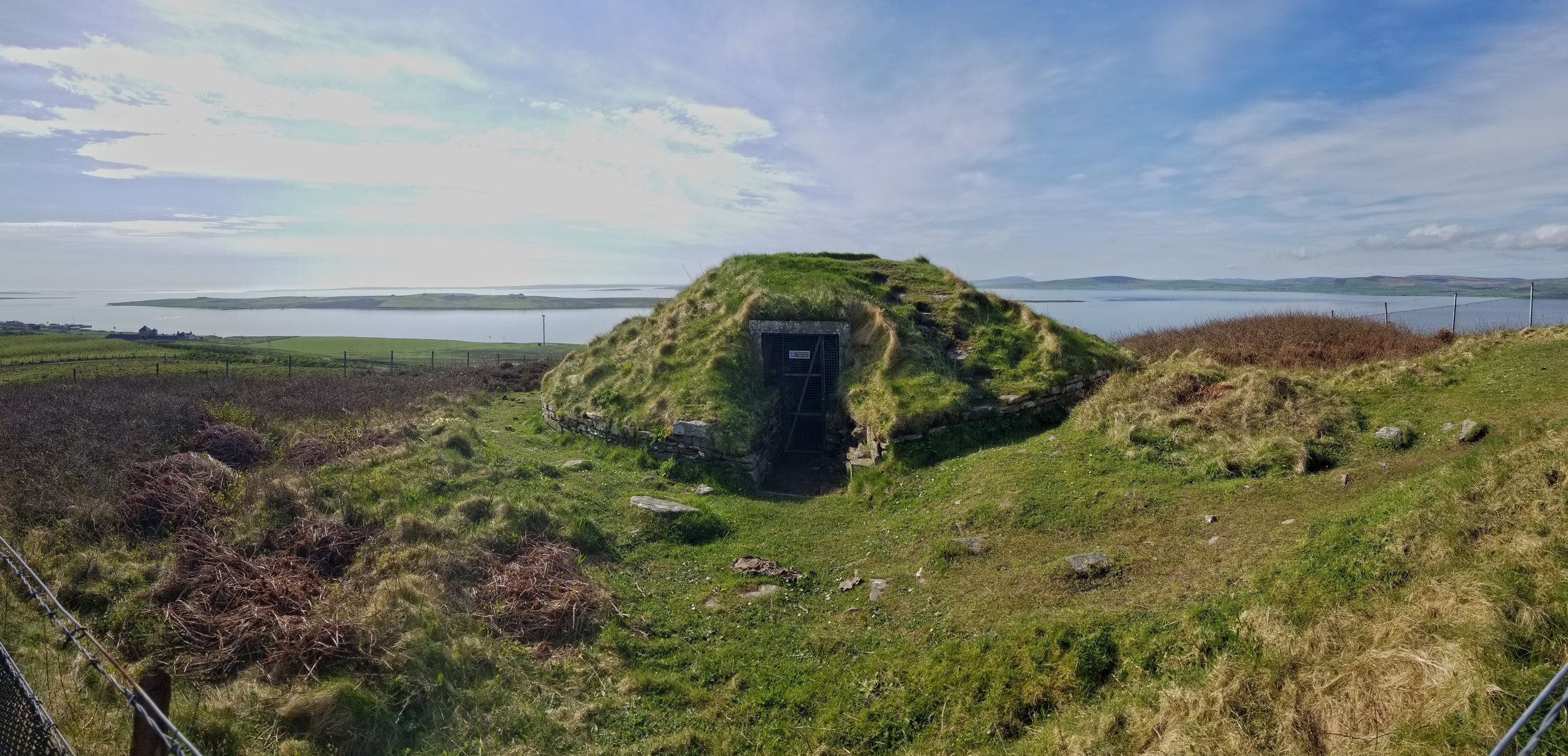 The 3,000-year-old chambered cairn of  Taversoe Tuick  on Rousay overlooks the island of Wyre and the surrounding Wyre Sound.