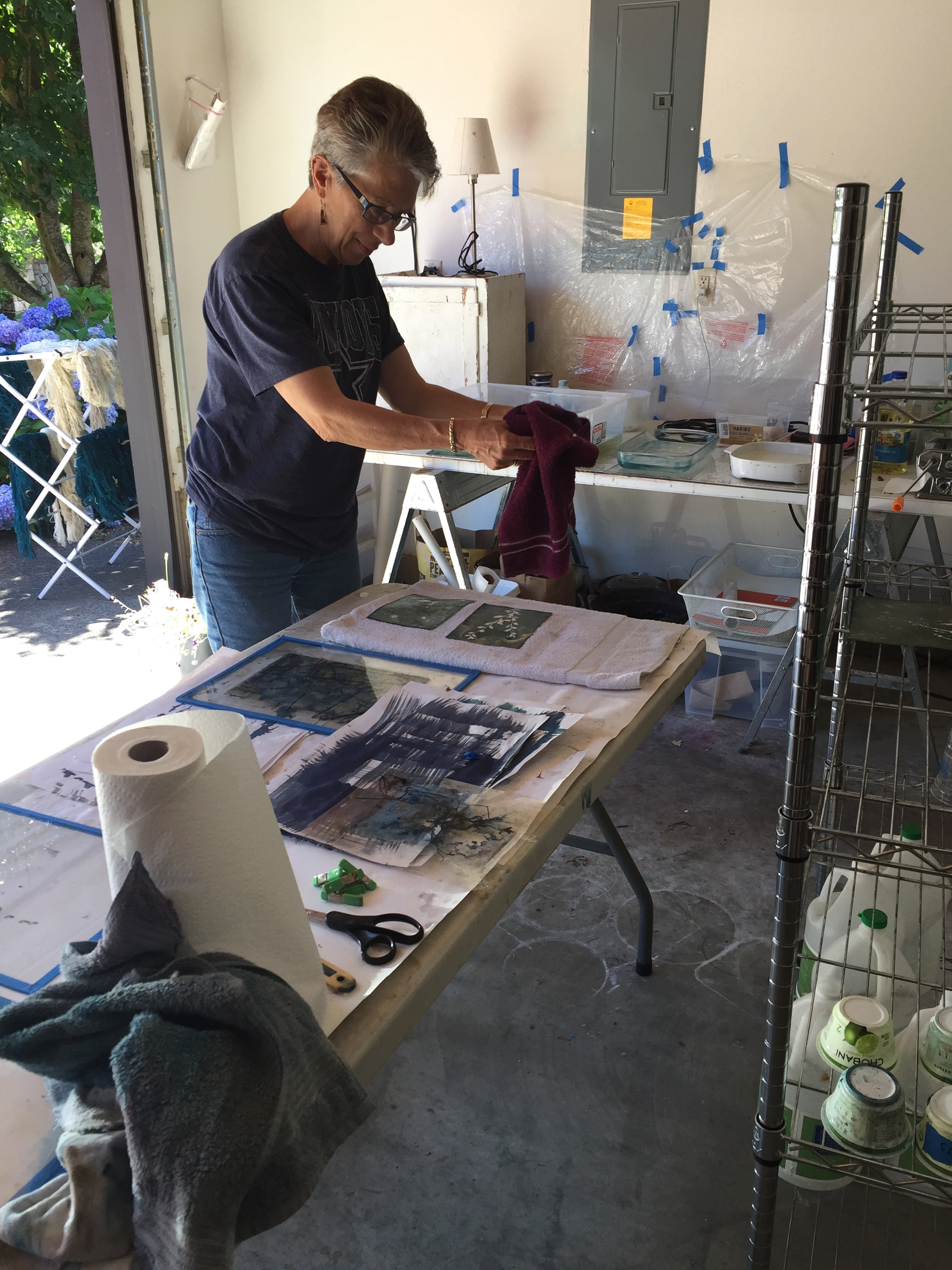 Blotting the cyanotypes fresh out of their bath