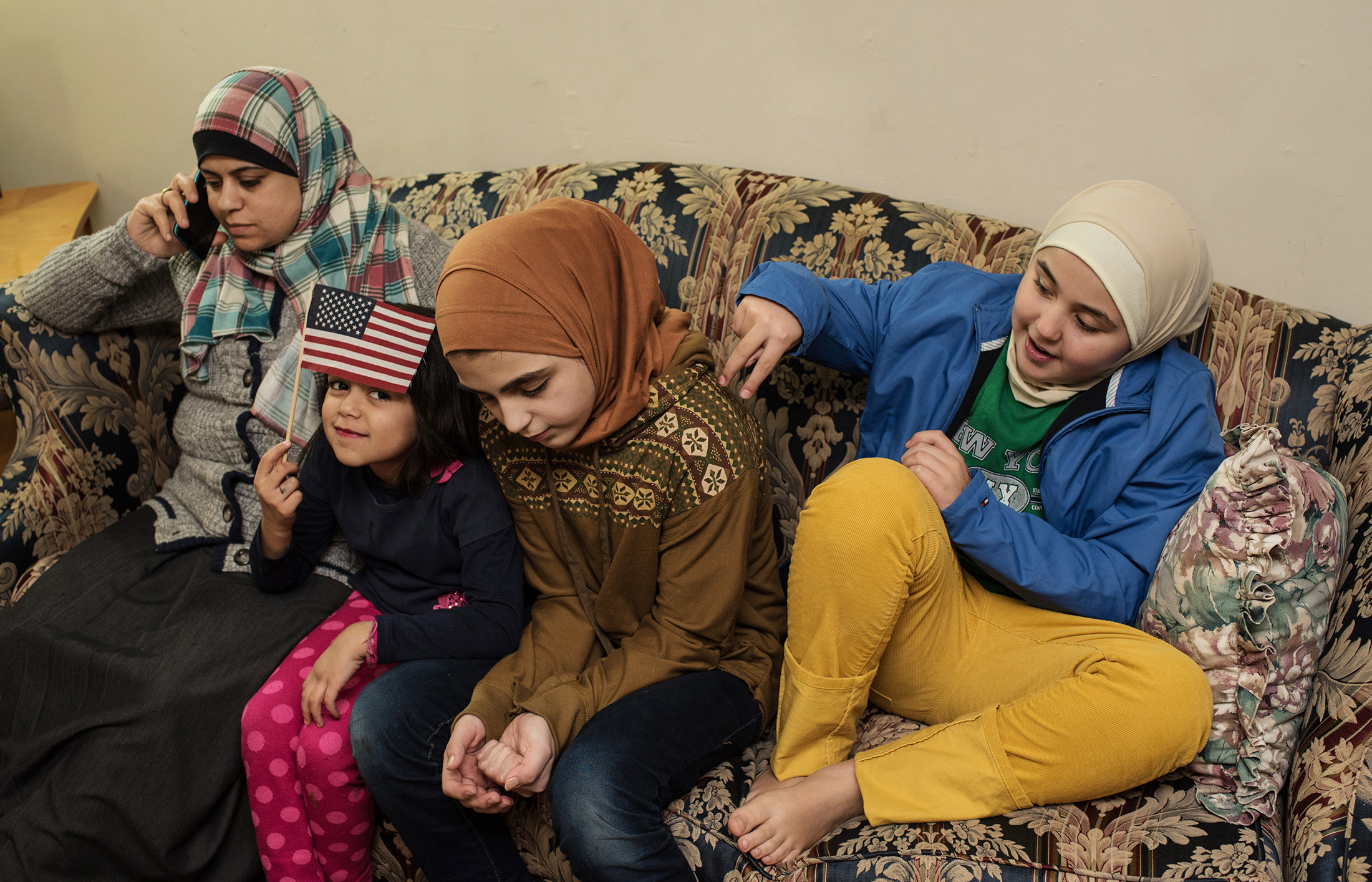 For many refugee families, the children rapidly surpass their parents' in english abilities. They become their parent's liaison with the world.jpg