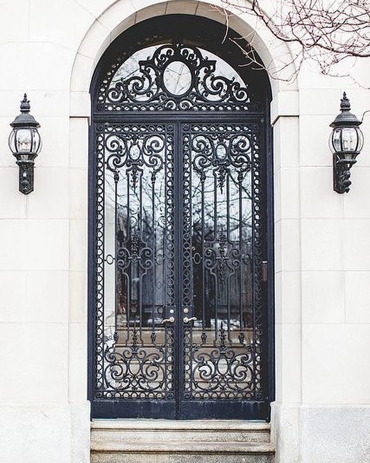 WROUGHT IRON - Lasting and beautiful, yet a forgotten gem in this modern day and age. Wrought iron on a main glass door is a sight to behold like this one here, dont you think?