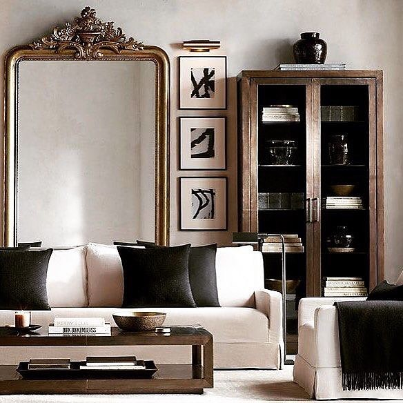 ORNATE MIRROR - Have them at your living room to give the illusion of space and spice up a monochrome look to a whole new level, as done here by Restoration Hardware.